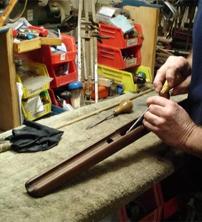 Paul servicing a firearm